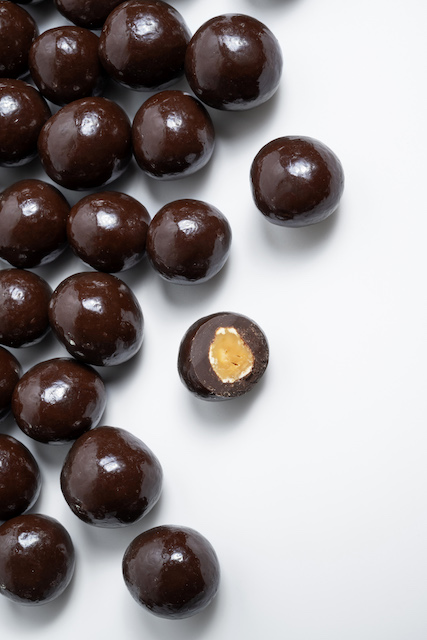 Hazelnuts coated with dark chocolate